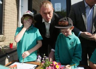 Liberal Democrats leader Tim Farron joins pupils for a gardening class during his visit to Lewannick Primary School in Cornwall, where he unveiled the party's landmark education funding policy. 10 May 2017.
