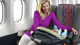 Mother and infant passenger on airplane