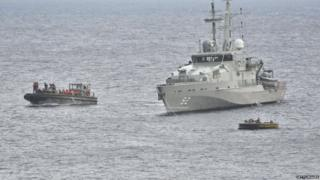 A Royal Australian Navy Ship takes part in a rescue effort of suspected asylum seekers after their boat capsized, on June 22, 2012 on Christmas Island.