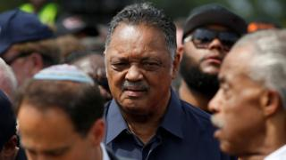 Reverend Jesse Jackson with fellow activist Reverend Al Sharpton (R) at the start of a march to the Department of Justice, August 28, 2017.
