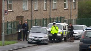 Police at the property where a double shooting took place in Bristol