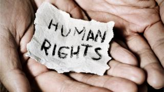 Man with the text human rights