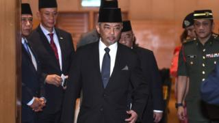 This pictures taken on January 11, 2019 shows Tengku Abdullah Sultan Ahmad Shah (C) walking after a meeting in Kuala Lumpur