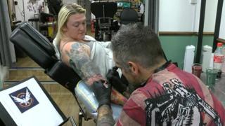 Bronwen Matthews receives another tattoo from artist Lee Clements