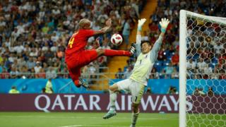 Belgium's defender Vincent Kompany (left) tries to score against Japan's goalkeeper Eiji Kawashima during the match between Belgium and Japan on 2 July