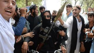 militant and residents in Jalalabad