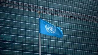 The UN flag waving outside its headquarters in Manhattan
