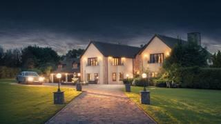 Millionaire mansion at night