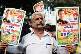 "A Congress party supporter holds placards in support of Rahul Gandhi for the country""s next prime minister outside the party headquarters in New Delhi on December 11, 2018, as"
