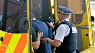 Suspect put into police van