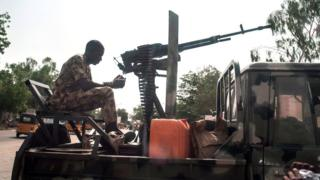 A soldier sits on the back of an armed vehicle in Maiduguri in north-eastern Nigeria on July 7, 2017