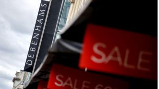 Debenhams store with Sale signs outside