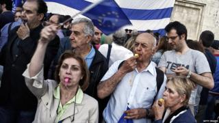 Pro-Euro protesters take part in a rally in front of the Parliament on June 22. 2015 in Athens, Greece.