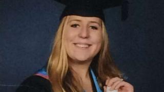 Katie Locke in her graduation gown