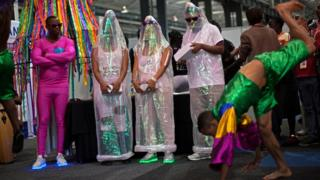 People in man-sized condoms during a performance at the Durban International Conference Centre, in Durban, South Africa - Tuesday 19 July 2016