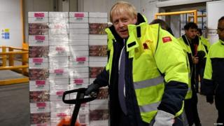 Boris Johnson during a visit to the headquarters of the Iceland's supermarket chain
