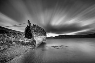 A ship lies at Clift Sound beach