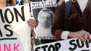 Activists hold a picture of Jamal Khashoggi during a demonstration in Washington DC