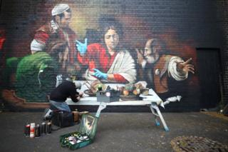 healthy fod for babies An artist paints a mural depicting the Supper at Emmaus by Caravaggio