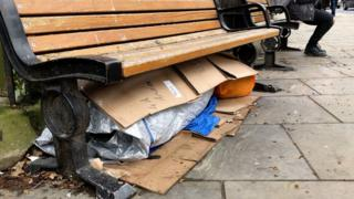 Homeless person under bench