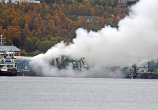 Gutted Russian trawler Bukhta Nayezdnik overturns in Norway