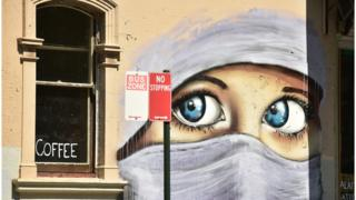 A mural showing the eyes of a Muslim woman wearing a headscarf, painted on a wall in an inner city suburb of Sydney (October 2, 2014)