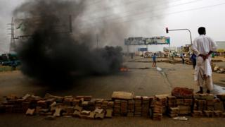 "A Sudanese protester stands near a barricade on a street, demanding that the country""s Transitional Military Council handover power to civilians, in Khartoum, Sudan June 4, 2019."
