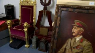 A throne chair, an ornamental bell stand and a portrait of Sir Henry Wilson MP