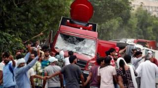 Crowds smashed television trucks in Panchkula after the verdict