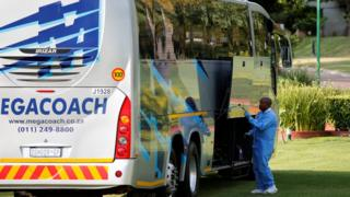 A forensic investigator searches for clues on a bus alleged to have been used by the 36 Dutch tourists who were robbed at gunpoint on Sunday in a brazen heist while traveling from Johannesburg's main international airport to their hotel, officials said
