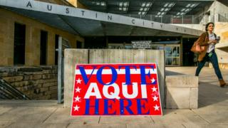 Sign reads: Vote Aqui Here