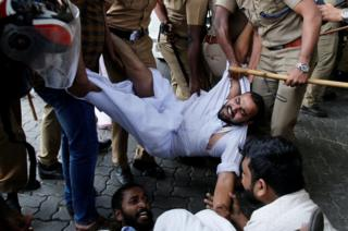 Police remove members of Kerala Students Union, the student wing of India's main opposition Congress party, as they take part in a protest after two women entered the Sabarimala temple, in Kochi, India, 2 January 2019.