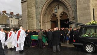 Mourners at the funeral for Paddy Doherty at St Eugene's Cathedral