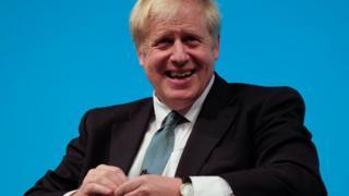 A smiling Boris Johnson