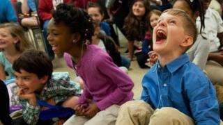 A group of children laughing