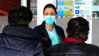 Healthcare professionals at work at the hospital of Schiavonia, northern Italy, 8 March 2020