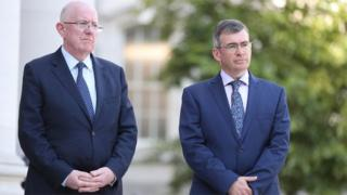 Charlie Flanagan (left) has defended the incoming garda commissioner Drew Harris (right)