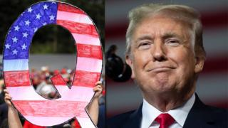 Donald Trump y una pancarta de los seguidores de la teoría de la conspiración QAnon.