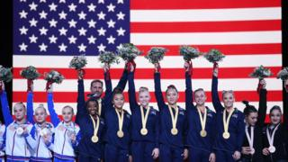 Simone-Biles-and-USA-team-winning-gold-medal-at-World-Championships