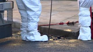 PSNI forensic officers examining the murder scene