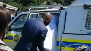 The bride getting into a police vehicle
