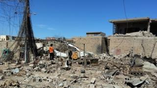 An Iraqi man inspects the rubble of a house destroyed in an apparent airstrike carried out by the Iraqi army on Falluja (08 March 2016)