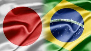 Bandeiras japonesa e brasileira se fundindo