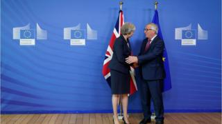 European Commission President Jean-Claude Juncker shakes hands with British Prime Minister Theresa May