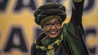 Winnie Mandela waves as she attends the 54th ANC National Conference at the NASREC Expo Centre in Johannesburg.