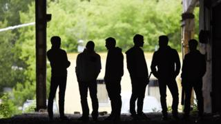 A gang in silhouette (library image)