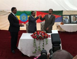 Ethiopia's Prime Minister Abiy (C) handed the key to the embassy to Eritrea's President Isaias