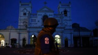 A security official stands guard outside St Anthony's Shrine in Colombo on April 23, 2019