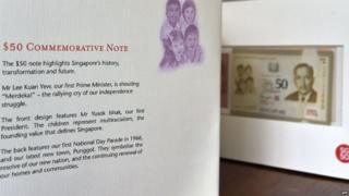 "A misspelling of Singapore's first president ""Yusok Ishak"" (third para) on a folder kit of the 50 Singapore dollar commemorative note displayed in Singapore on August 21, 2015"