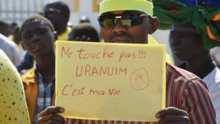 A Niger man holds a placard reading 'Don't touch!!! Uranium is my life' during a demonstration against French nuclear giant Areva.